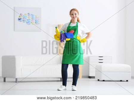 Young professional with cleaning supplies indoors