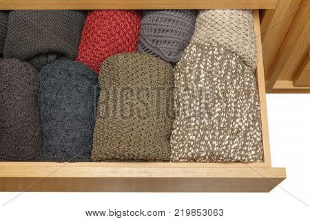 A well-organized closet drawer open. Storage system. Wardrobe order with white background