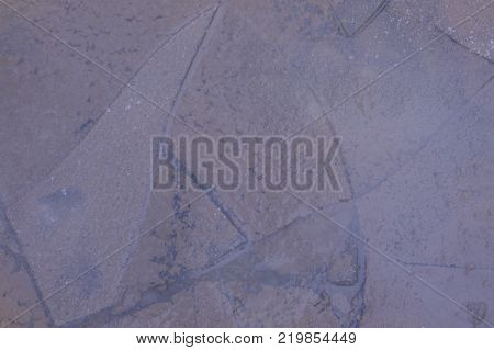 Cracks on an ice surface of the river a natural background