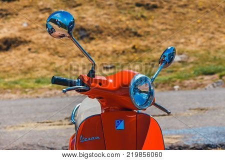 Portugal Madeira July 04 2016: Red scooter Vespa parked in the mountains on Madeira Island Portugal