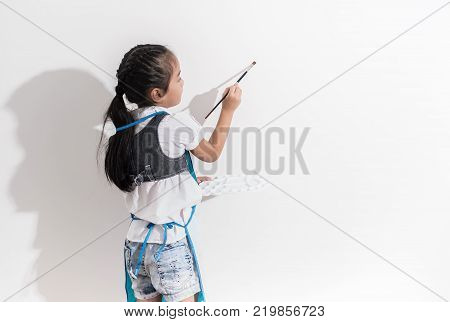 Little girl drawing on the wall.family and relaxing concept.