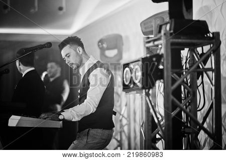 Three Stylish Bearded Man Well Dressed With One Blonde Girl In White Dress Posed. Musician Band Or S