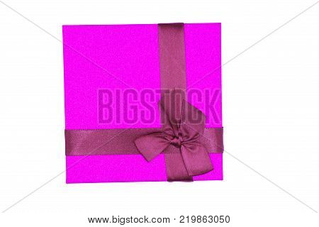 Pink gift wrapped present with rosy satin ribbon bow isolated on white