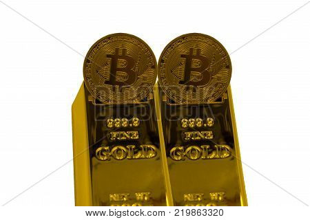 Close up of Male hand and gold bullion with Bitcoin symbol on it .
