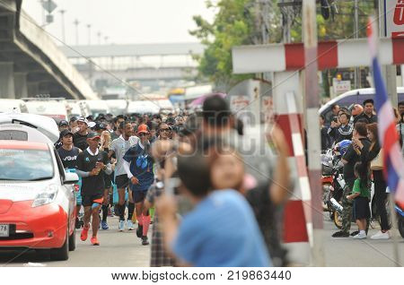 Nonthaburi - DEC 6 2017 : On the way of Thai celebrity rocker 'Toon Bodyslam' takes on 55-day running marathon to raise money for public hospitals, 2,191-km cross-country charity run, philanthropist.