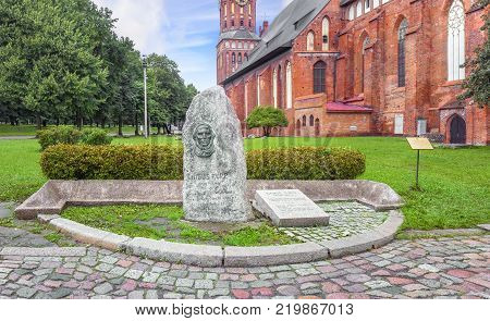 Kaliningrad, Russia - July 27, 2017: Memorable sign to Julius Rupp against the background of the Konigsberg cathedral.