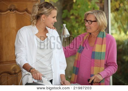 Girl ironing for an older woman