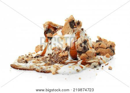 Ice cream ball with caramel sauce and cookies on white background