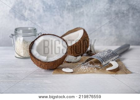 Fresh and desiccated coconut on white table
