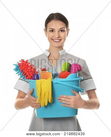 Woman with cleaning supplies on white background