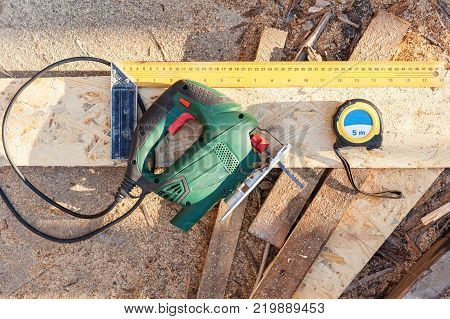 Construction worker use jig saw for cutting a Wood Particle Board or fiberboard
