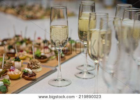 Catering Banquet table with canapes snacks festive table slices glasses reception