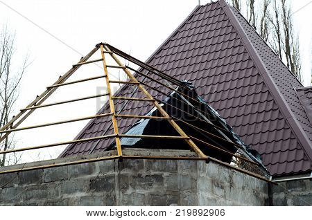 Roof Construction With Logs And Metal Tile