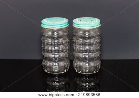 a cooks pair of glass salt and pepper shaker set. These are the first s/p shakers I ever remember seeing used in the house. There was a shelf built into the stove where these were kept.