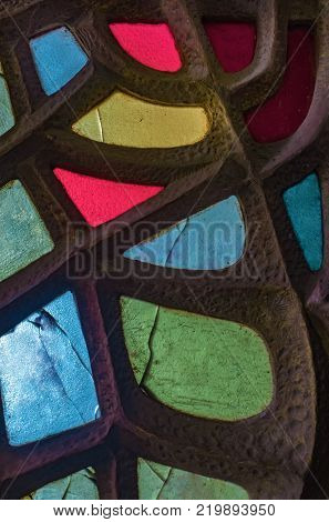 Panel of colorful stained glass in contemporary shapes