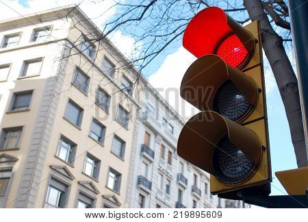 Traffic lights showing red color. Glowing red light. Traffic light in the city. Red traffic light in the city street.