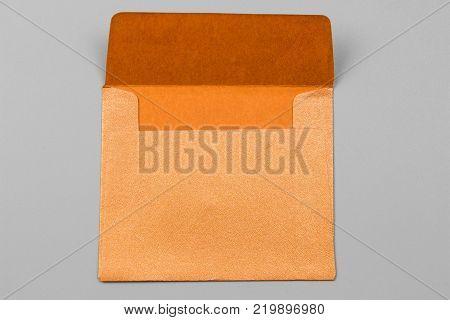 Envelope card on gray background. orange envelope