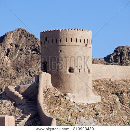 Close up on a watch tower in old Muscat Harbour area. The old city of Muscat is separated from the rest of modern Muscat by coastal mountains