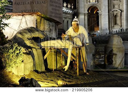 VATICAN CITY VATICAN STATE - DECEMBER 14 2017: detail of the statues in the Vatican crib a corpse being put in a hole in the rock