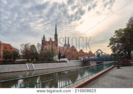 Wroclaw Old Town. Cathedral Island (Ostrow Tumski) is the oldest part of the city at the sunset. Cathedral of St. John and the Odra (Oder) river Tumski bridge