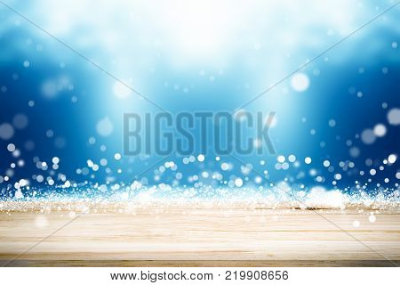empty wooden on blue lighting backdrop. christmas light background. Wood table top. can used for display or montage your products