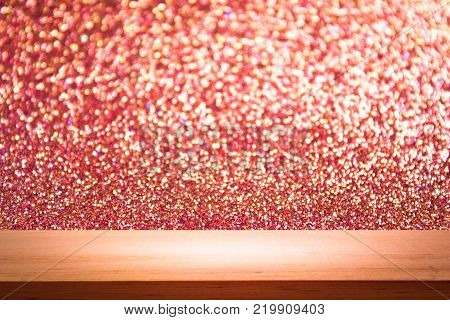 empty wooden on red lighting backdrop. christmas light background. Wood table top. can used for display or montage your products
