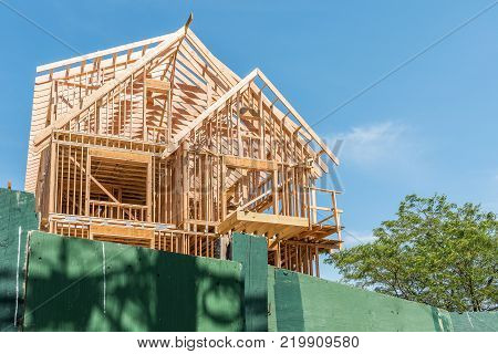 Construction Building New Modern Unfinished Townhouses Or House With Wooden Frame And Nobody