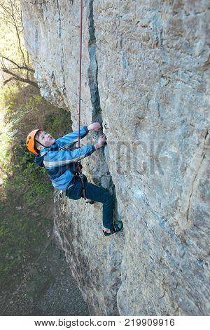 Kid Rock Climber Climbs The Cliff.