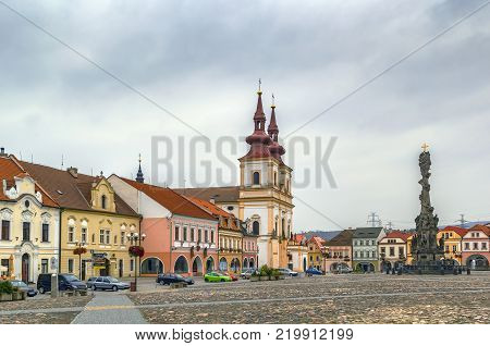 Church of the Exaltation of the Holy Cross and Holy Trinity Column on main square of Kadan Czech republic
