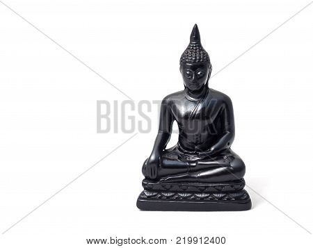 A Buddha carved in soapstone on a white background