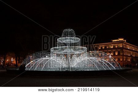 Winter evening and the New Year's fountain at the Admiralty in St. Petersburg
