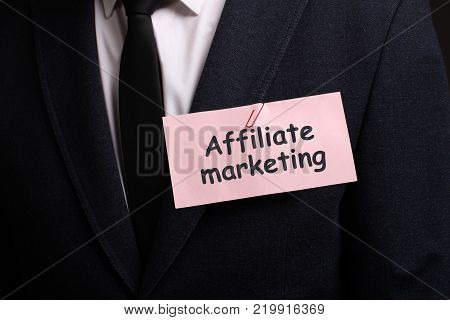 The concept of business technology the Internet and the network. A young entrepreneur working on a virtual screen of the future and sees the inscription: Affiliate marketing