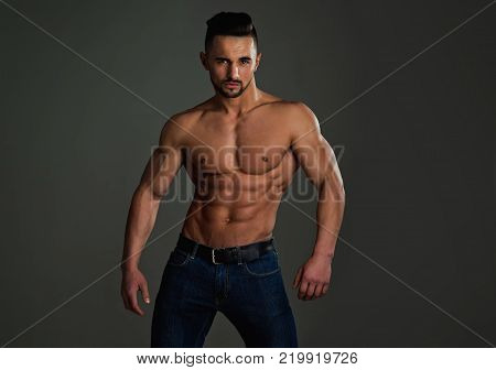 Man With Muscular Wet Body And Torso.