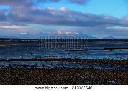 View of the Isle of Arran from Ayr beach Scotland