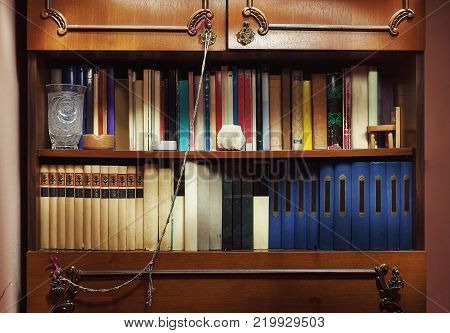 Closeup view of old closet full of old books.