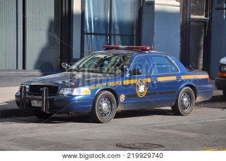 BUFFALO, NY, USA - JULY 22, 2011: New York State Trooper Ford Crown Victoria Police Car in downtown Buffalo, New York, USA.