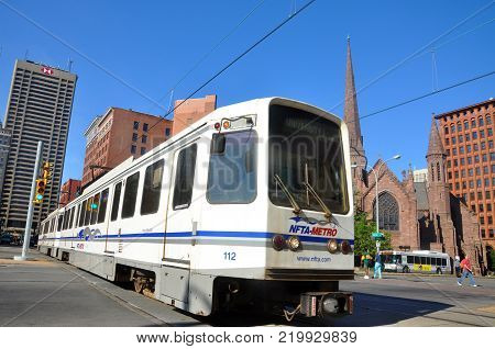 BUFFALO, NY, USA - JULY 22, 2011: Buffalo Metro Rail on Main Street at Church Street, with St. Paul's Episcopal Cathedral in downtown Buffalo, New York, USA.