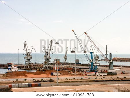 Shipping industry old cargo  port of piraeus athens greece no visible logos on containers and cranes.