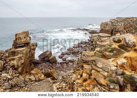 Cliff Rocks, Foggy Landscape of Portugal. Vintage Wallpaper, Rocky ocean shore