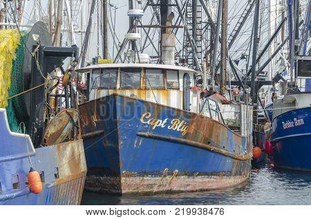 New Bedford, Massachusetts, USA - December 26, 2017: Commercial fishing boat Capt. Bligh docked in New Bedford harbor