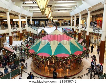 COSTA MESA, CALIFORNIA - DEC 19, 2017: Carousel Court at South Coast Plaza with Santa's Village  in the background.