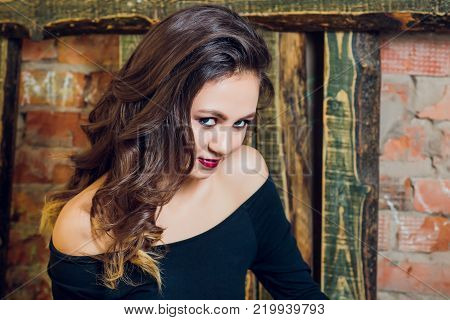 Portrait of young beautiful woman with bridal makeup and coiffure. Modern smokey eyes make up. Studio shot. Salon make-up poster