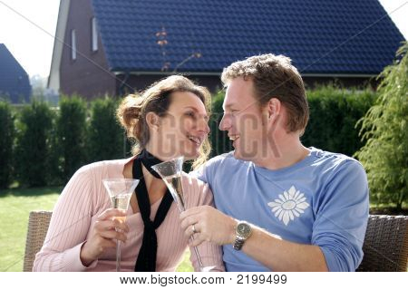 Happy Couple In The Garden