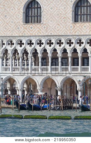 VENICE, ITALY-SEPTEMBER 22, 2017: Doge's Palace on Piazza San Marco, boulevard with tourist. The palace was the residence of the Doge of Venice,  the museum is currently located here