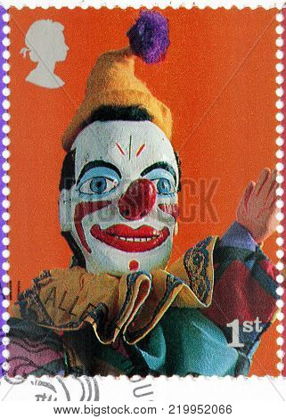 LUGA, RUSSIA - AUGUST 20, 2017: A stamp printed by GREAT BRITAIN shows Clown glove puppet - character from Punch and Judy Puppets Show, circa 2001