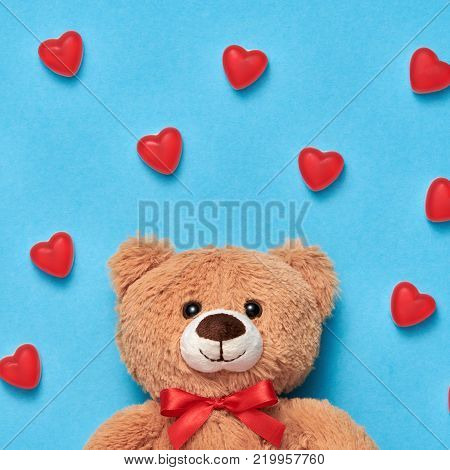 Valentines Day. Love. Teddy Bear with Candies Sweets Hearts. Minimal. Art. Cute bear on Red hearts background, Dessert. Love, Fun Romantic style, Vintage creative