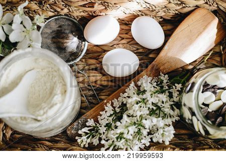 ingredients for cooking eggs, flour, chocolate in basket