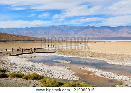Death Valley National Park, California, USA - November 23, 2017. View of Badwater Basin, at elevation of 85.5 meters below sea level, in the Death Valley National Park, with people.