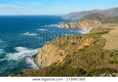 View of Pacific coast in Big Sur state parks in California, with Bixby bridge historic landmark.