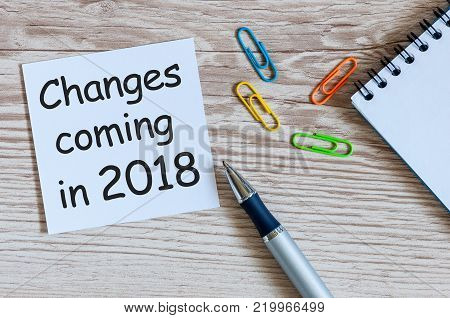 A note Changes coming in 2018. With office or school supplies.